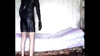 Guy in leather shorts coupled with latex shirt