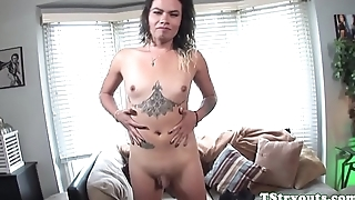 Alluring tgirl fingers her ass at casting