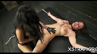 Sassy baneful subfusc likes the feeling of a strapon downward into her gaping pussy
