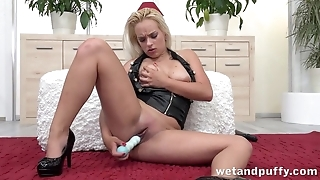 Blonde in leather jacket plays with favorite dildo