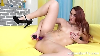 Ginger hottie sticks long vibrator into shaved pussy